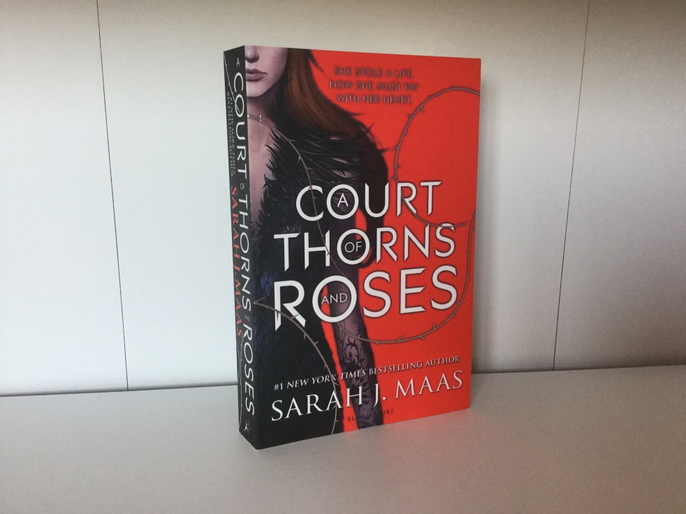 The cover of A Court of Thorns and Roses by Sarah J. Maas
