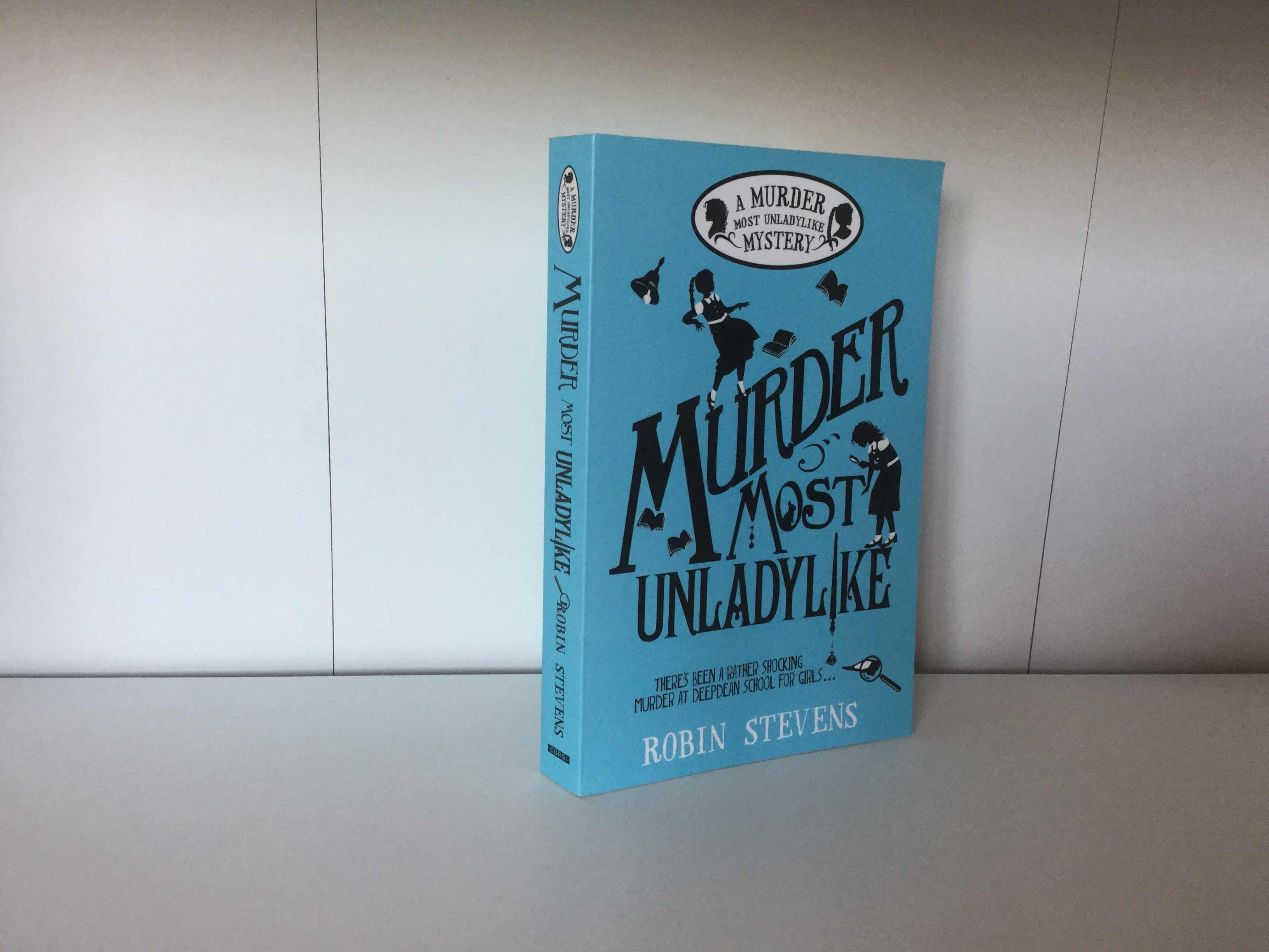 The cover of Murder Most Unladylike by Robin Stevens