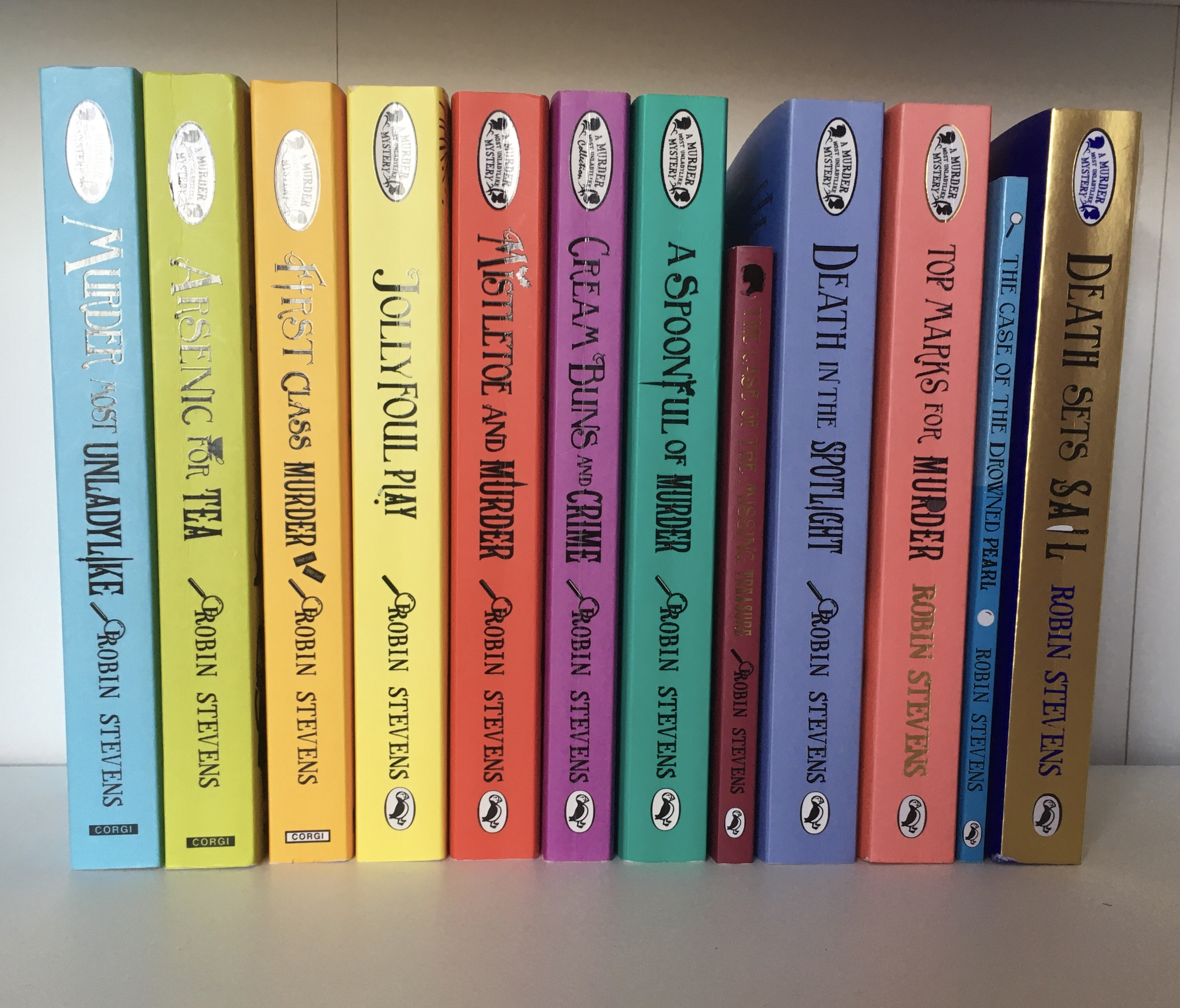 The spines of the Murder Most Unladylike series by Robin Stevens