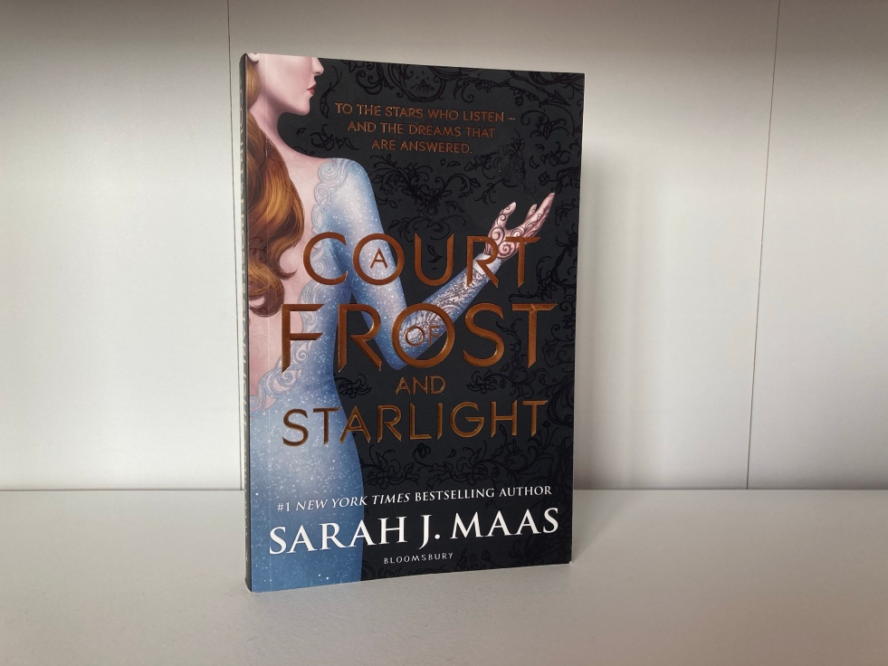 The cover of A Court of Frost and Starlight by Sarah J. Maas