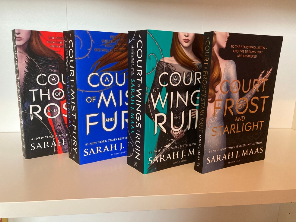 The covers of the A Court of Thorns and Roses series by Sarah J. Maas