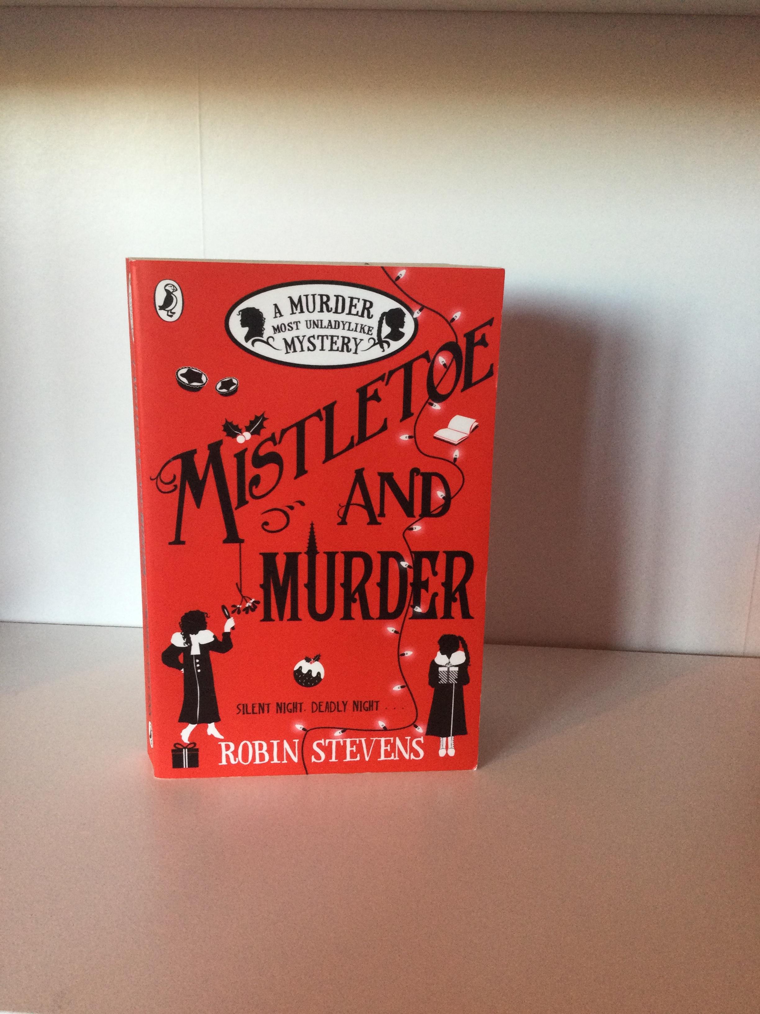 The cover of Mistletoe and Murder by Robin Stevens